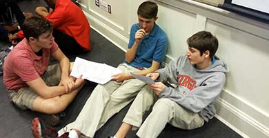 Student athletes discuss different leadership styles during their personalized leadership workshop.