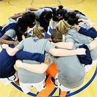 building and reinforcing team culture- basketball team huddle